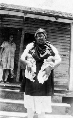 African American midwife holding twins