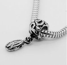 NEW!  Seeds of Strength Pandora®-style charm.  Designed and created by Caesar Azzam.  A portion of the proceeds benefit women in recovery.  A PERFECT graduation (or any occasion) gift for the POWERful women in your life!