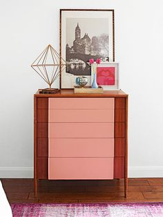 A painted pink stripe down the center of this dresser provides an easy update! Get more ideas here: http://www.bhg.com/decorating/decorating-style/flea-market/house-tour--fresh-retro-style/?socsrc=bhgpin111714easydresserupdate&page=9