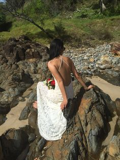 This backless gown, made by Vancouver wedding dress designer Hrissa Soumpassis, is cut from luxurious ivory stretch lace that's perfect for a destination wedding Backless Gown, Stretch Lace, Designer Wedding Dresses, Vancouver, Lace Skirt, Destination Wedding, Gowns, Sun Kissed, Engagement