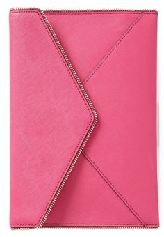 Finishing off a très chic summer ensemble with this fierce, hot pink clutch for an unexpected splash of color.