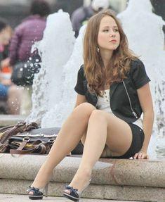 Hot girl in short skirt and sheer pantyhose.: