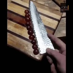 Very sharp knife cuts grapes