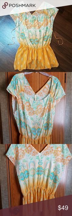 Free People sheer Tunic size Medium Beautifully feminine bohemien style tunic, brass bell beaded at the end if drawstring,  bottom of tunic is embellished with sequin and beads Sheer fabric/100% polyester  PERFECT FOR SUMMER Free People Tops Tunics