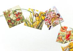 This mini Flower Fairy bunting is cute for a playroom or nursery. It has gorgeous illustrations of Cicely Mary Barkers Fairies with all sorts of pretty flowers and fairies. This fairy bunting has been up-cycled from the gorgeous pictures of a much-loved Flower Fairies book by Cicely Mary Barker.  This listing is for ONE mini garland of fairy bunting with 6 small flags. Each flag measures 6 cm x 6 cm (2.5 in x 2.5 in)  The bunting has flower fairy pictures on both sides so it could be hung at...