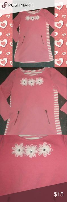 Gymboree Girls Fleece Contrast A-Line Dress- Sz 6 This dress is super cute.  Its a fleece dress with solid salmon pink on the front and 3 flowers near the neckline and zipper pockets..  On back, the fleece is a salmon pink and white stripe. I love the contrast between the solid and the stripe.  Size 6.  There is one teeny discoloration on the back.  I took a clear pic of it.  Its really barely noticed in person.  Wanna bundle? 👍 Gymboree Dresses Casual