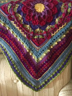 Afghan I'm working on in a Crochet-a-long (CAL)  called Around the Bases inside square is Enchanted Garden Tote pattern by Courtney Laube which is crocodile flower and Sophie's garden combined.