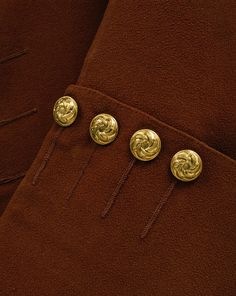 Sleeve Detail of Frockcoat Britain, UK,1750-1769 (made), Wool and linen, brown silk twill and fustian, and silver-gilt buttons. Twenty silver-gilt buttons with a moulded rococo design are placed from the neck to hem down the front, although only 12 have functioning buttonholes from the neck to the waistline. The remainder are decorative. Seventeen other buttons below the pocket flaps and at intervals in both the side skirt openings. There are two front pockets at the waistline with five…