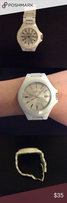 Invicta Women's Watch Great Invicta White Watch with gold.  Fits a very small wrist unless you purchase extra links.  Needs battery & in good condition.  Not Rubber. Invicta Accessories Watches