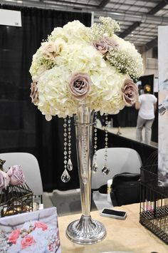 Tall wedding centerpiece with crystals by flowershackblooms.com