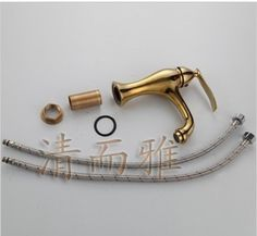 105.00$  Watch here  - Clean and elegant gold-plated bathroom basin mixer full of hot and cold taps European antique copper faucet A11