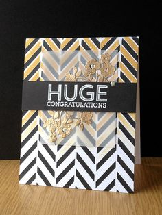 handmade card ... HUGE Congratulations from paperpicnic on Flicker ... black and white with metallic gold ... bold background tweed pattern stenciled on in black ... then shifted and stenciled partway down  ... luv the vellum panel with gold embossed flowers ... fambulous look!! ... Hero Arts