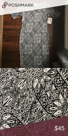 BNWT Jaquord Black and White Floral LuLaRoe Julia Jaquord fabric runs a little smaller than other materials. Black and white floral. LuLaRoe Dresses