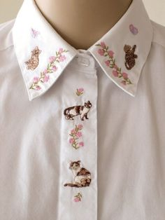 Cats embroidered shirt.