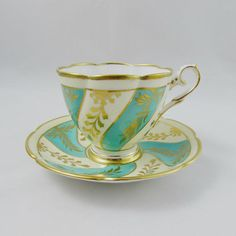 Vintage Tea Cup and Saucer, Turquoise Blue with Gold Designs, Made by Royal Stafford, English Bone China Royal Stafford, Turquoise Color, Vintage Tea, Gold Designs, Bone China, Cup And Saucer, Tea Cups, English, Tableware
