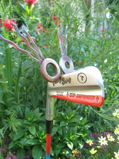 Patty the Golf Gal - Garden Art: This yard art is made from a recycled Patty Berg Cup Defender golf club.  She is 32 inches tall and has a blue and red striped shaft.  Looks great in the garden, or even in a flower pot.  Patty lives on the wild side and isn't afraid of all the attention she gets!...