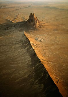 Ship Rock, New Mexico - a low aerial photo of a great volcanic remnant and sacred Native site, by Gary Braasch 2004
