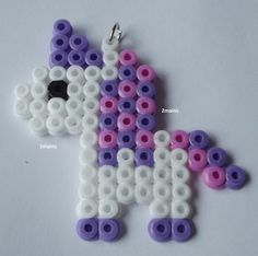 Unicorn pendant Made with beads (Hama) For necklace or to put on a keychain size approx x cm Another model or color on request/order Perler Bead Designs, Hama Beads Design, Diy Perler Beads, Perler Bead Art, Pearler Beads, Melty Bead Patterns, Pearler Bead Patterns, Perler Patterns, Beading Patterns