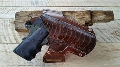 Custom built OWB leather holster with ostrich leg accent for a 1911
