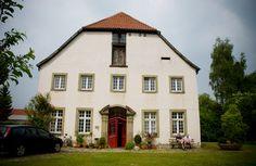 Renovated farm house...love all the little windows!