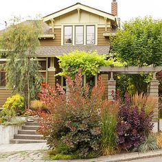 via bhg. front yard color palette, matching well with house exterior colors.