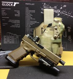 Glock 19 w/ ICE magwell, Haley Skimmer Trigger, suppressor sights, extended barrel, and Trijicon dual-illuminated RMR.