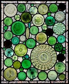 Stained glass from bottle bottoms - neat idea for the windows on either side of the front door ....