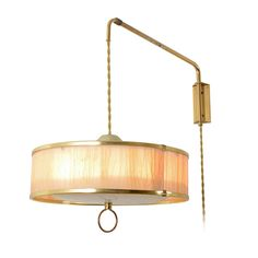 Mid-Century Wall-Mounted Pulley Lamp, circa 1955 | From a unique collection of antique and modern wall lights and sconces at https://www.1stdibs.com/furniture/lighting/sconces-wall-lights/