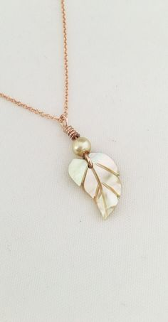 Small mother of pearl carved shell necklace with gold filled rose gold chain.  https://www.etsy.com/listing/607760451/rose-gold-filled-necklace-vintage-carved
