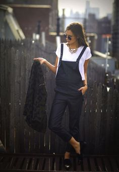 black overalls.white tee.eagle statement necklace.