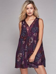 Swingy and sheer slip in a dotted jacquard, featuring a floral print and plunging V-neckline, trimmed in lace.