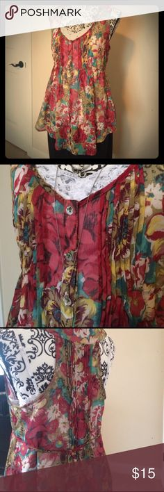 American Rag sleeveless blouse American Rag CIE long sleeveless blouse. Sheer material. I'm showing a white tank underneath (not included) in the picture. Very cute summer blouse! Made of polyester. Machine washable. American Rag Tops Blouses