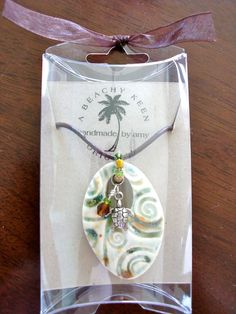 Ocean swirl seahorse ceramic pendant by Beachykeenpottery on Etsy, $25.00