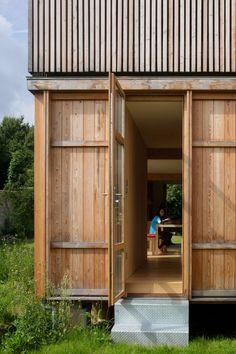 """"""" House in the garden """" is a residential project completed by Jean-Baptiste Barache and Sihem Lamine - ARBA. The house has an area of 130 sqm Detail Architecture, Plans Architecture, Industrial Architecture, Interior Architecture, Japanese Architecture, Timber Cladding, Tiny House Cabin, House Built, Cabins In The Woods"""