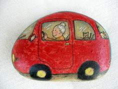 Granny in a red car with cats - funny painted rock.