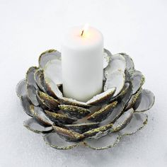 I used the clam shells left over from lunch to make this candle holder. All you need are a wood base, hot glue, Mod Podge, and glitter.