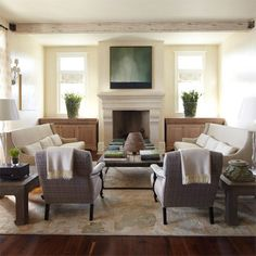 Excellent furniture layout by Erika Powell - lots of seating and I love the symmetry.