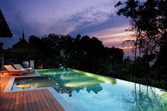 Over a Bay in Phuket. About 15 minutes from Phuket's airport, the resort comprises 28 private residences and 39 one- and two-bedroom pool villas.