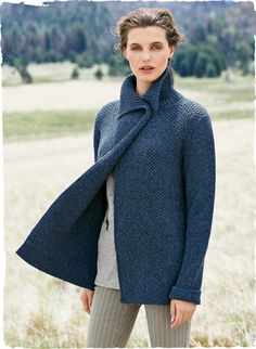 In a glorious hue of heathery Lapis, the jacket is a substantial knit of alpaca (93%) and nylon (7%) in a textural honeycomb  stitch. A cozy layer for cool days, wear it open and drapy or fastened at the high ribbed neck with the horn toggle, as shown.