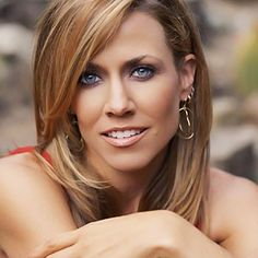 Sheryl Crow.  My 5th grade muic teacher.  Really.  I dream that she would sing at my wedding.
