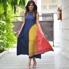 This extremely chic dress will adore your body like your best friend. Dividing your body into vertical halves and drawing focus to one particular side, this dress will make you look slimmer and will keep your chic quotient high with beautiful block printed asymmetric panels. This dress is part of our beautiful hand block printed collection which is an ode to the traditional Indian art of hand block printing. The block printed fabrics are created by skilful artisans, work magic on cotto...