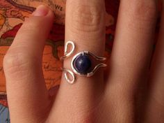 Aquamarine Lapis Lazuli Silver Wire Wrapped Ring  A great thing about this wire ring is that it's strong but adjustable. I work-hardened the wire to preserve its shape but leave it with enough flexibility so you can adjust it to a perfect fit.  In this ring I wrapped Lapis Lazuli, is
