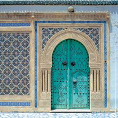 Turquoise door and lovely tile ... Tunis?