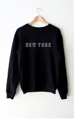 "- Description Details: 'New York' oversized fleece sweatshirt in black. Brand: NYCT Clothing. Unisex, oversized/loose fit. Measurements: (Size Guide) XS/S: 38"" bust, 27"" length, 25"" sleeve length M/L:"