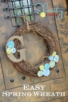 A grapvine wreath can be embellished quickly (and easily!) to add a hint of spring to your front door.  There's a tutorial for the rosette flowers, too!
