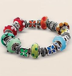 Rainbow Pandora bracelet. While I wouldn't want mine to be so repetitive, I love the idea of a few beads in each colour. It would go with everything.