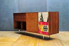 "USA, c.1950s. Vintage George Nelson Herman Miller ""Thin Edge"" Walnut Hi-Fi Stereo Cabinet/Credenza. With Sven Markelius Pythagoras Fabric Speaker Cover. Sliding Door, Record Cabinets, and Drop Down Door to Reveal Turntable and Storage Shelf."