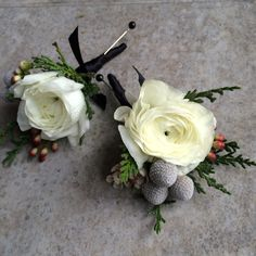 www.sophisticatedfloral.com Ranunculus winter boutonnières with berries