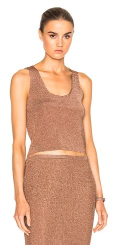 Cropped sleeveless top by Tibi. 82% viscose 18% metallized poly.  Made in China.  Dry clean only.  Metallic rib knit fabric.