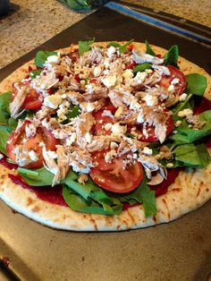 BALSAMIC CHICKEN PIZZA:  Boboli thin pizza crust 2 chicken breasts 1 can tomato paste 1 tbsp brown sugar 1 tbsp honey 1 tsp lemon juice 1 1/2 tsp Worcestershire sauce 1/2 cup chopped mushrooms 2 sliced Roma tomatoes 2 cups spinach 1/3 cup feta cheese Balsamic vinegar  Preheat oven to 450 degrees...